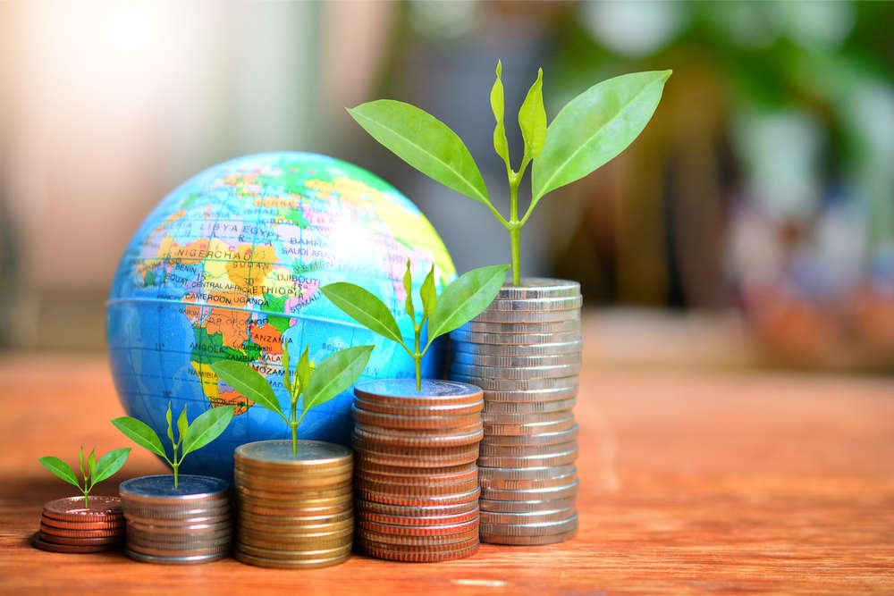 Grantors fund process efficiency and sustainability improvement projects that reduce wasted raw materials, energy and pollution. Picture of earth globe and coins.